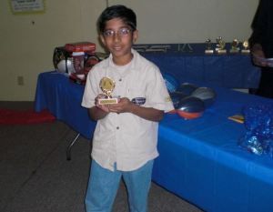 Mustafa proudly displays his trophy for his community service award.